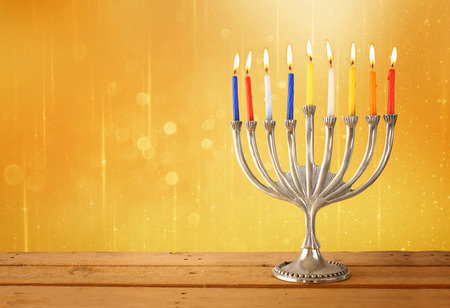 hanukkah: Image of jewish holiday Hanukkah background with menorah traditional candelabra and Burning candles with glitter overlay
