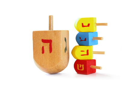 dreidels: wooden colorful dreidels spinning top for hanukkah jewish holiday isolated on white
