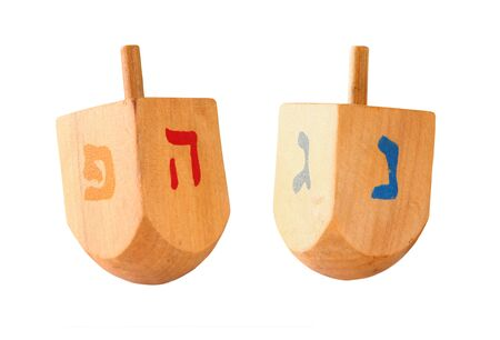 hanukka: wooden colorful dreidels spinning top for hanukkah jewish holiday isolated on white