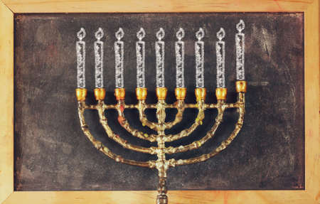 hanukiah: image of jewish holiday Hanukkah with drawing menorah candles traditional Candelabra over chalkboard background