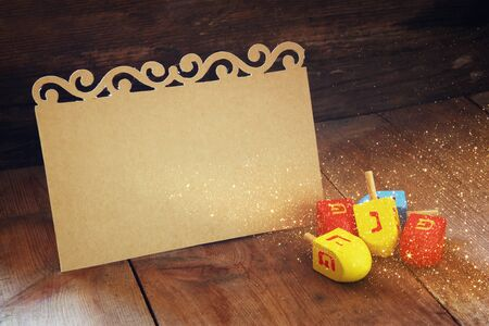 chanukkah: image of jewish holiday Hanukkah and wooden dreidels spinning top with empty card for adding text