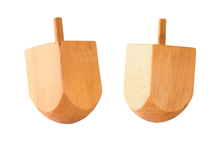 spinning top: wooden colorful dreidels spinning top for hanukkah jewish holiday isolated on white
