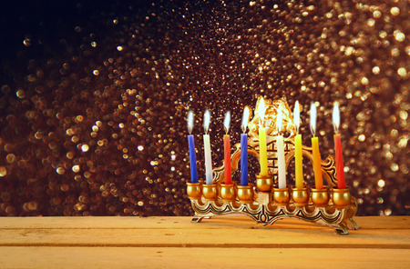 menorah: Image of jewish holiday Hanukkah background with menorah traditional candelabra Burning candles over black background with glitter overlay