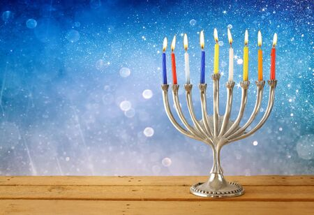 chanukah: low key image of jewish holiday Hanukkah with menorah traditional Candelabra Stock Photo