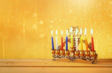 hanukka: low key image of jewish holiday Hanukkah with menorah traditional Candelabra . glitter background