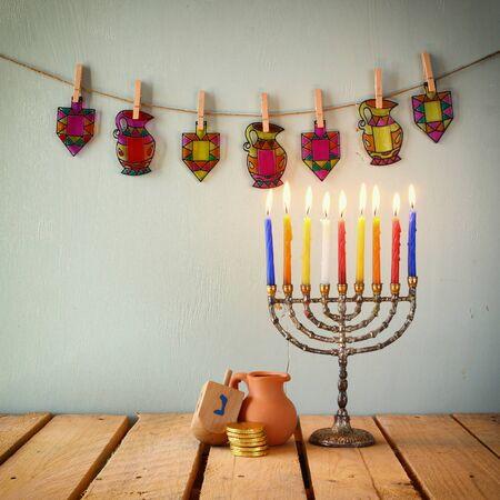 lit candle: image of jewish holiday Hanukkah
