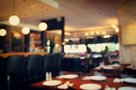 restaurant people: image of abstract blurred background of restaurant lights