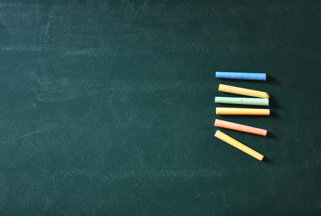room for text: top view image of green chalkboard and collection of many chalks. room for text Stock Photo