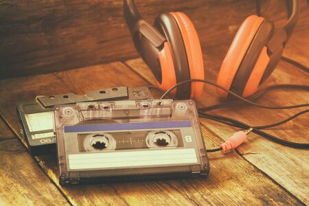 tapes: selective focus of Cassette tape over wooden table. image is instagram style filtered. Stock Photo