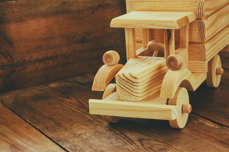 room for text: retro wooden toy car over wooden table. room for text. nostalgia and simplicity concept. retro style image Stock Photo