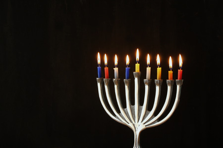 hanukkah: Image of jewish holiday Hanukkah background with menorah traditional candelabra and Burning candles