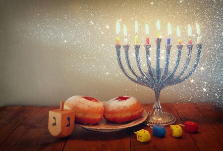 chanukah: image of jewish holiday Hanukkah with menorah traditional Candelabra and wooden dreidels spinning top