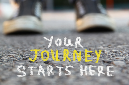 1st: image with selective focus over asphalt road and person with handwritten text - your journey starts here. education and motivation concept