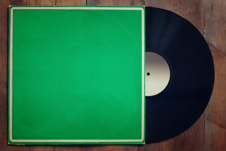 soul: records stack with record on top over wooden table. vintage filtered Stock Photo