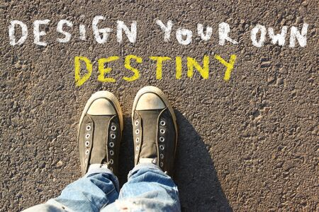 top view image of person in jeans and sneakers with the text - design your own destiny