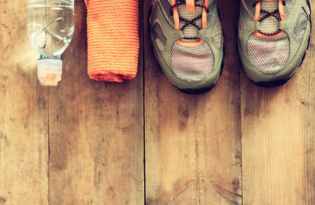 wooden shoes: fitness concept over wooden background. retro filtered