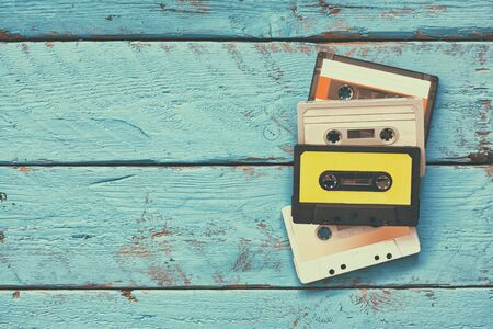 indie: close up photo of vintage cassette tape over aqua wooden table . top view. retro filtered Stock Photo