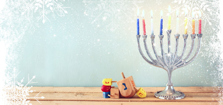 hanukkah: website banner image of of jewish holiday Hanukkah with menorah traditional Candelabra. retro filtered. glitter overlay