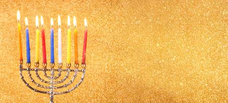 chanukiah: website banner image of of jewish holiday Hanukkah with menorah traditional Candelabra. retro filtered. glitter overlay