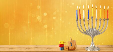 chanukah: website banner image of of jewish holiday Hanukkah with menorah traditional Candelabra. retro filtered. glitter overlay