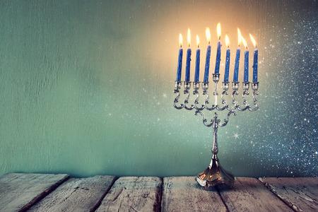 low key image of jewish holiday Hanukkah with menorah traditional Candelabra. filtered image