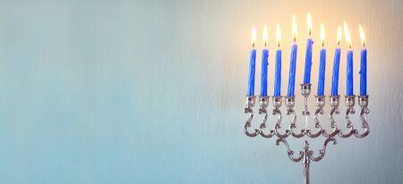 hanukka: website banner image of jewish holiday Hanukkah with menorah traditional Candelabra
