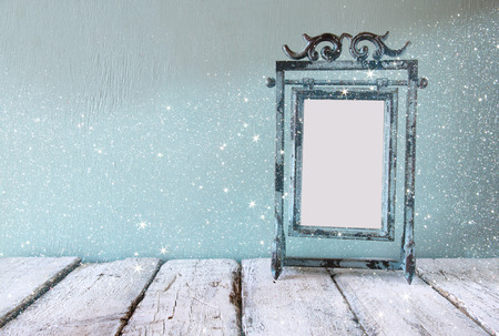 steel blue: low key image of old victorian steel blue blank frame. vintage filtered image with glitter overlay Stock Photo