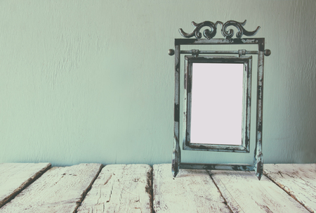 steel blue: low key image of old victorian steel blue blank frame Stock Photo