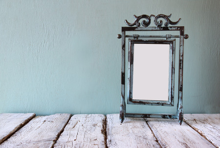 blue steel: low key image of old victorian steel blue blank frame Stock Photo
