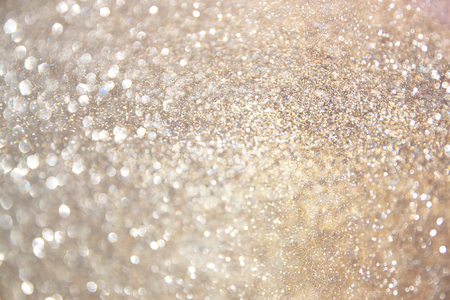 glitter background: glitter vintage lights background. gold, silver, and white. de-focused.