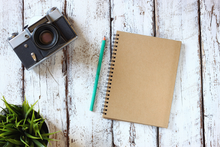 photography: top view image of open blank notebook, cup of coffee and old camera Stock Photo