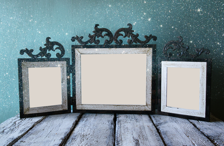 steel blue: low key image of old victorian steel blue blank frame . retro filtered image with glitter overlay