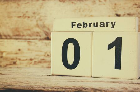 syllabus: image of February First wooden vintage calendar on white background