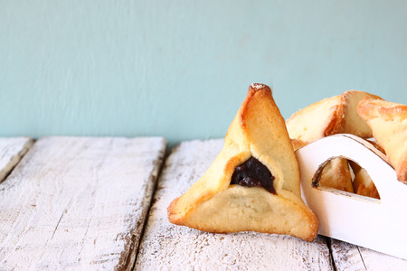 megillah: Hamantaschen cookies or hamans ears Purim celebration jewish carnival holiday. selective focus