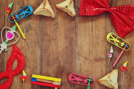 hamantash: top view photo of Hamantaschen cookies or hamans ears,noisemaker and mask for Purim celebration jewish carnival holiday. selective focus Stock Photo