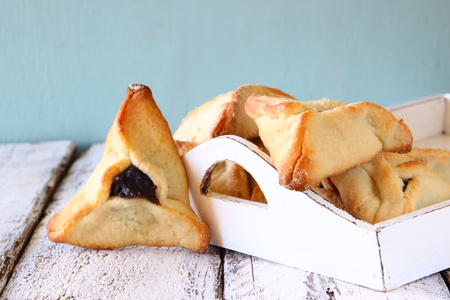 torah: Hamantaschen cookies or hamans ears Purim celebration jewish carnival holiday. selective focus