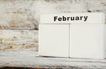 image date: image of February wooden vintage blank calendar on white background. ready to add date. template Stock Photo