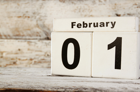 image of February First wooden vintage calendar on white background