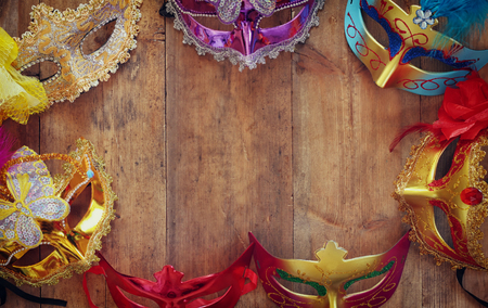 venetian mask: top view of colorful Venetian masquerade masks. retro filtered image