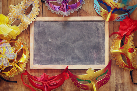 masquerade masks: top view of colorful Venetian masquerade masks. retro filtered image