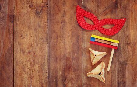 hamantashen: Purim celebration jewish carnival holiday and glitter background. selective focus
