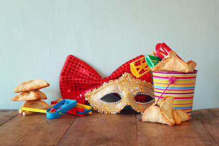 holiday maker: Purim celebration jewish carnival holiday and glitter background. selective focus