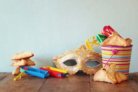 purim mask: Purim celebration jewish carnival holiday and glitter background. selective focus