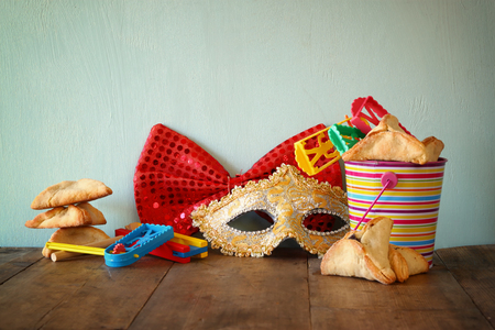 hamantasch: Purim celebration jewish carnival holiday and glitter background. selective focus