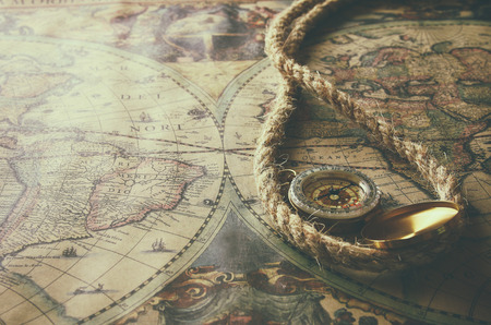 tresure: image of old compass  on vintage map