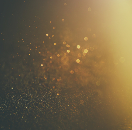 metalic: glitter vintage lights background. gold and black. defocused.