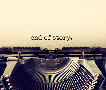 close up image: close up image of typewriter with paper sheet and the phrase: end of story. copy space for your text. terto filtered