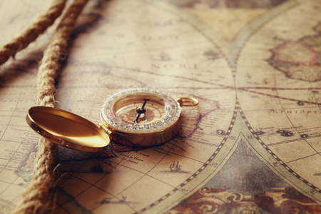 tresure: image of old compass and rope on vintage map Stock Photo