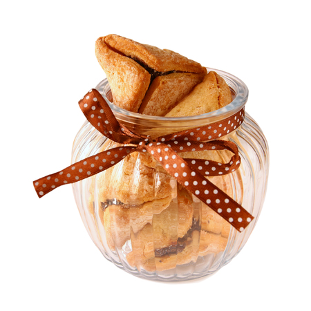 hamantasch: Purim celebration cookies jewish carnival holiday. selective focus. isolated on white