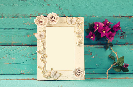 bougainvillea: vintage blank frame next to beautiful purple mediterranean summer flowers. template, ready to put photography